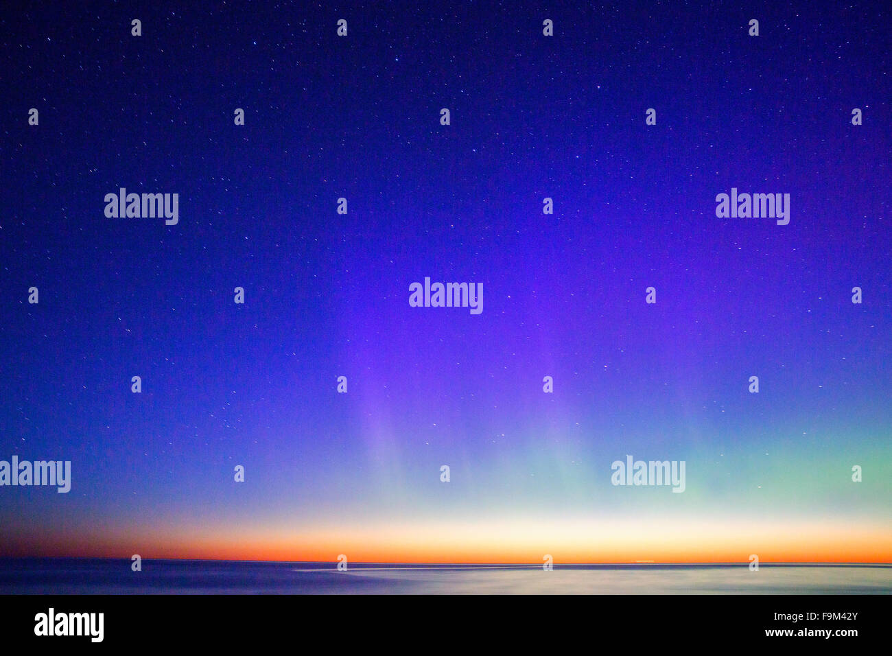 Aurora Borealis reaching the deep blue sky - Stock Image