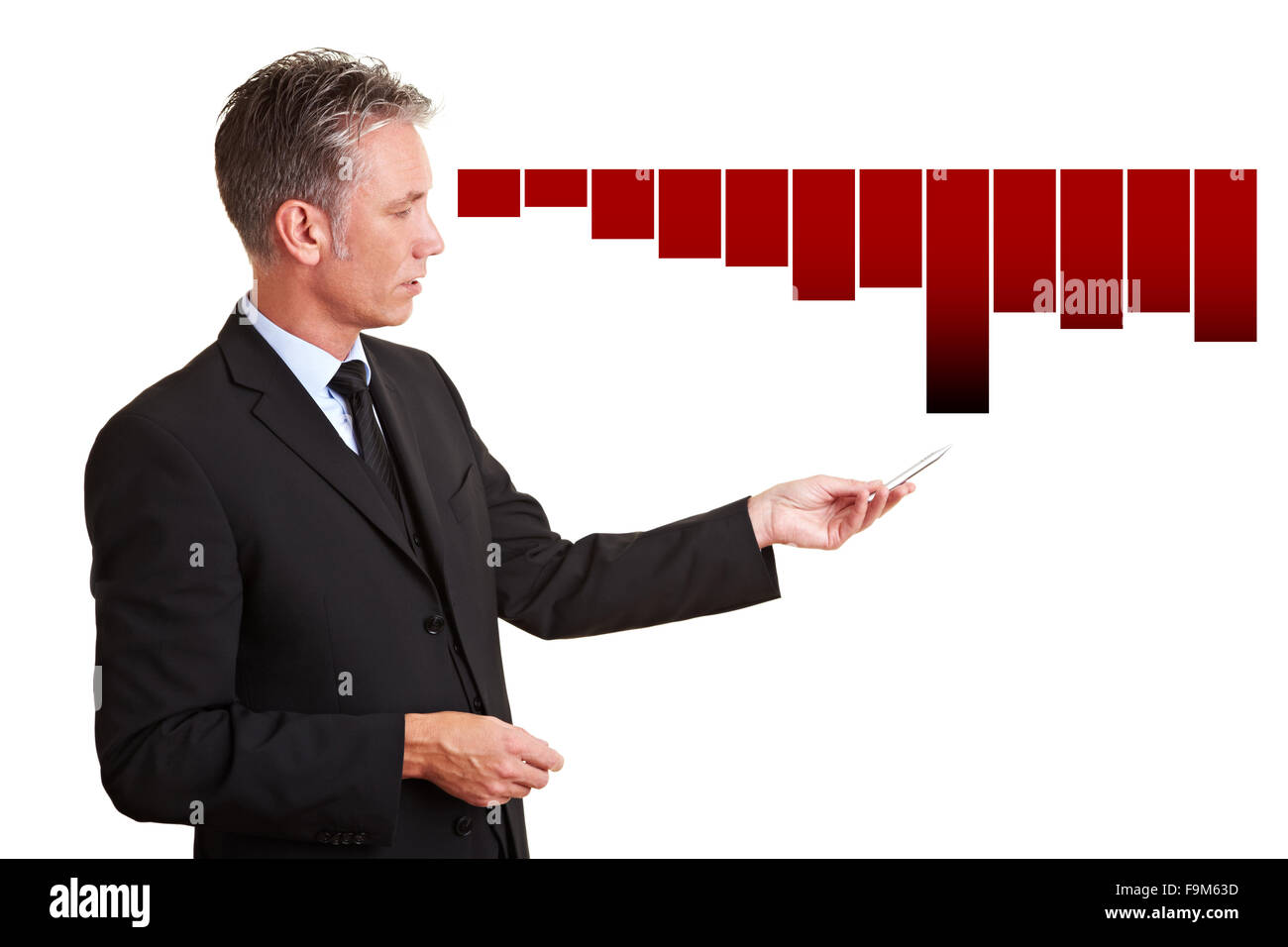 Senior manager explaining financial losses with a chart - Stock Image