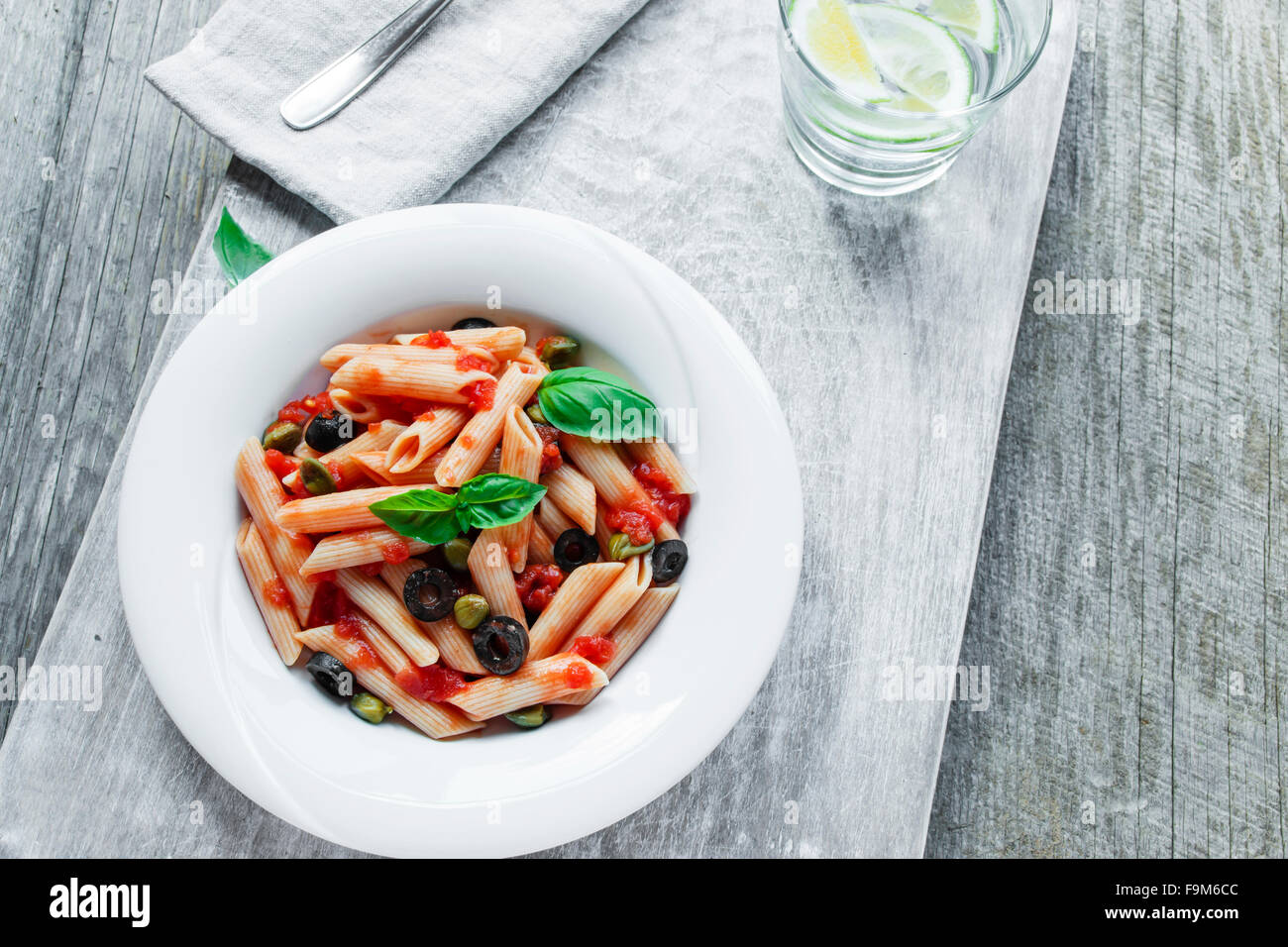pasta with tomato sauce olives and capers - Stock Image