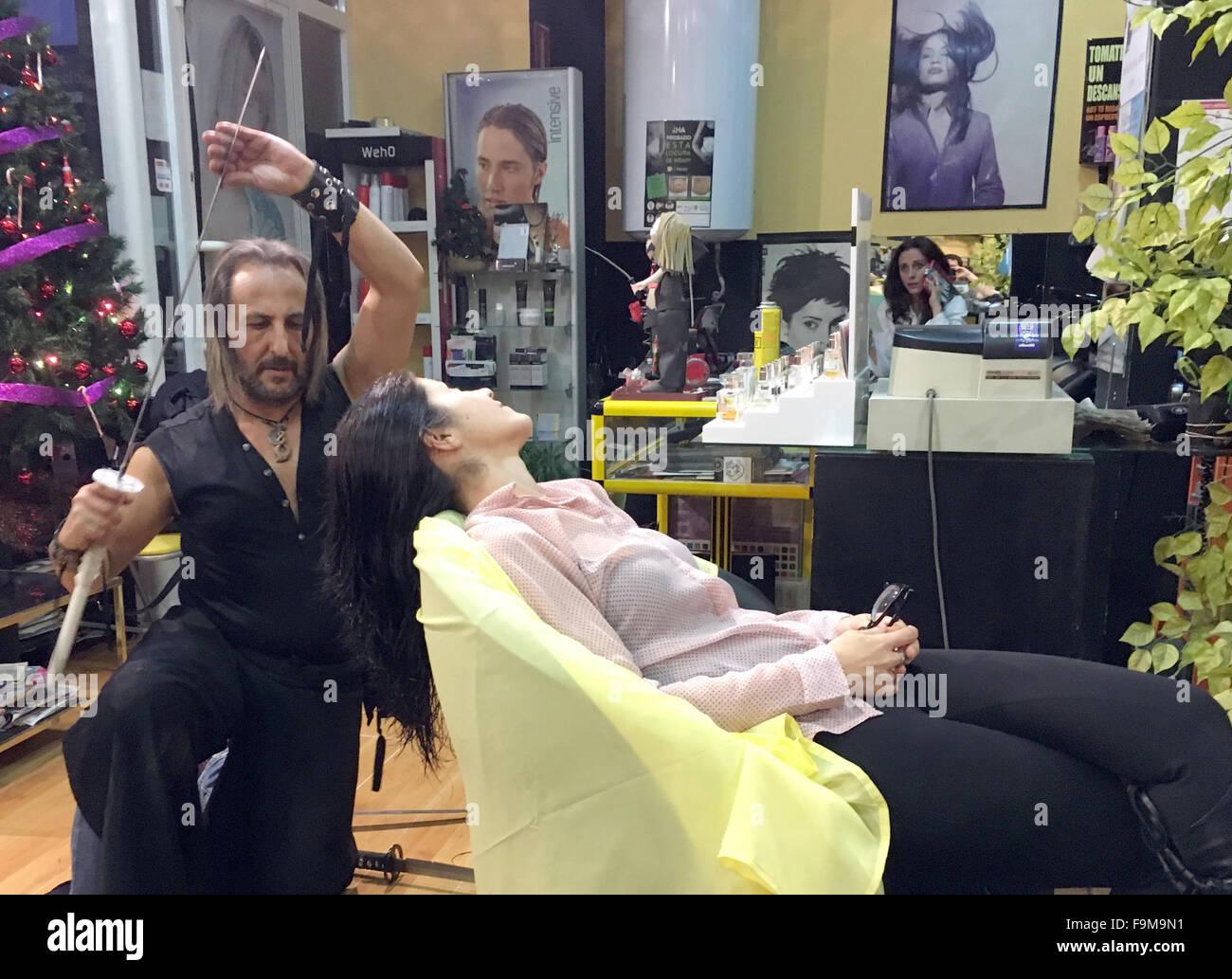 Madrid, Spain. 15th Dec, 2015. Hairdresser Alberto Olmedo (51) cuts Stock Photo: 92030429 - Alamy