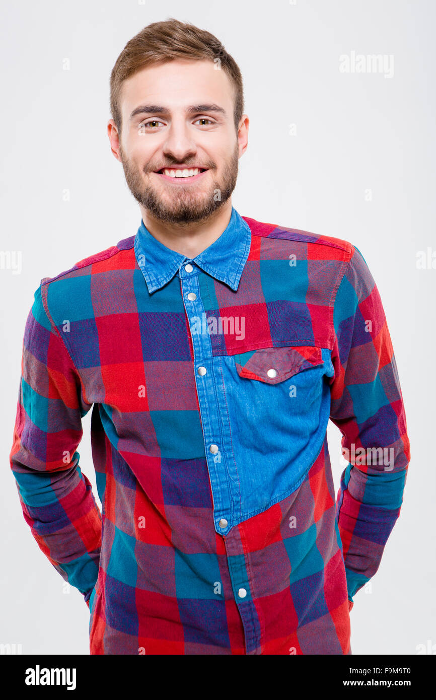 Portrait of a smiling casual man looking at camera isolated on a white background - Stock Image