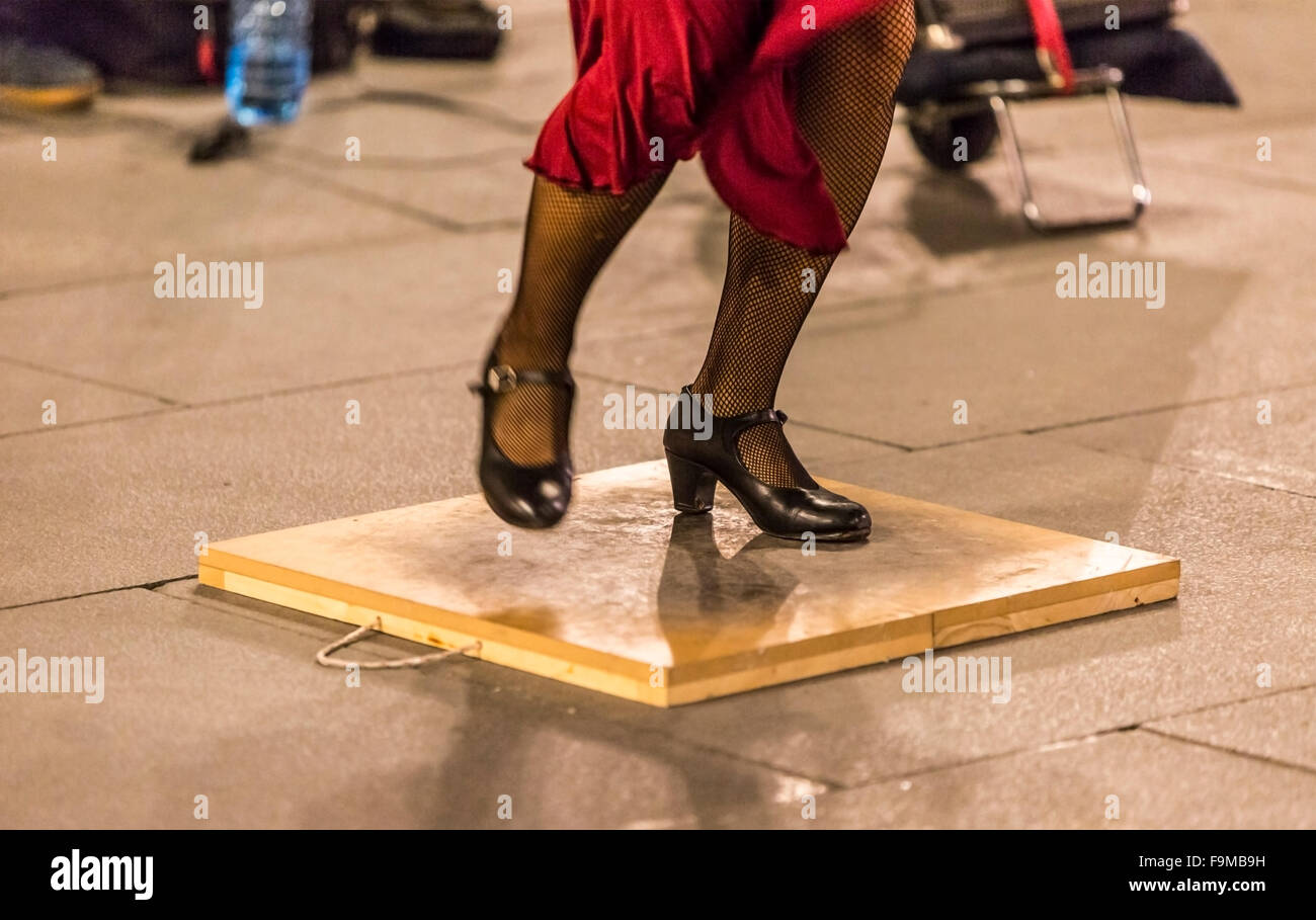 Detail of a flamenco dancer's feet performing in a street of a Spanish city. - Stock Image