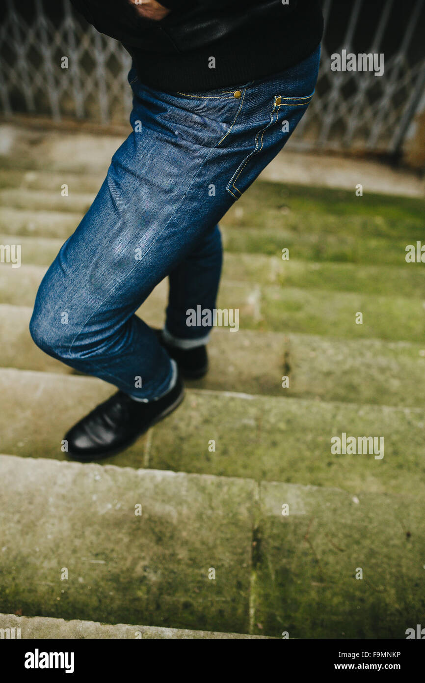 Confident man posing in selvedge  jeans - Stock Image