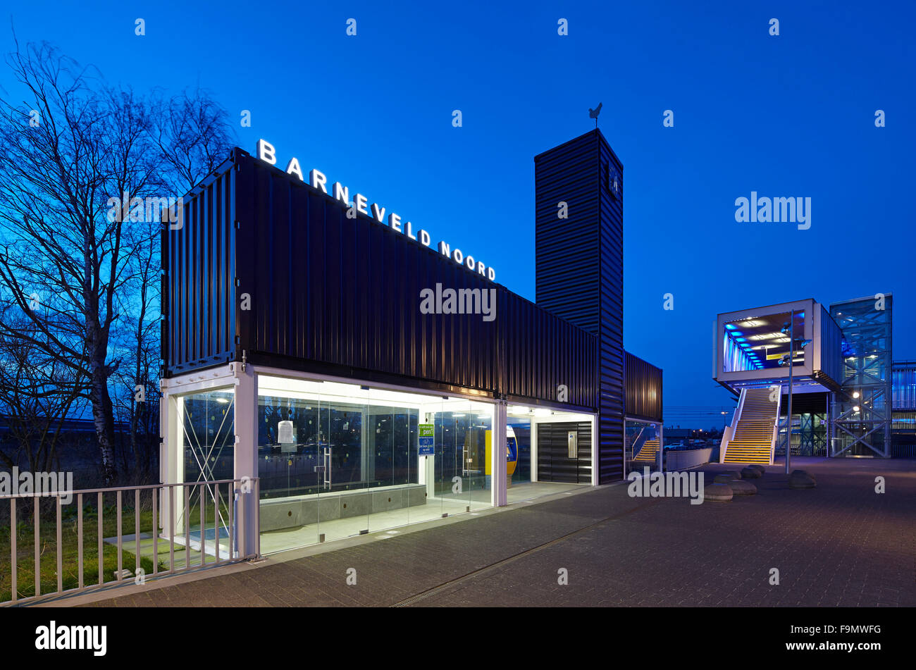 Barneveld Noord Station, a striking modern building with a central tower and glazed ground floor and black shuttering - Stock Image