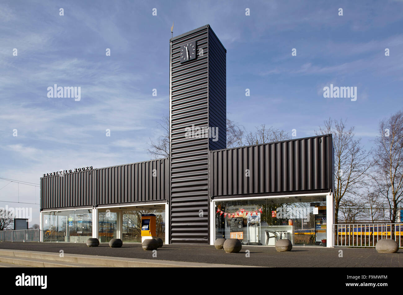 Barneveld Noord Station, a striking building with a central tower and large glass wall panels, creating a cross - Stock Image