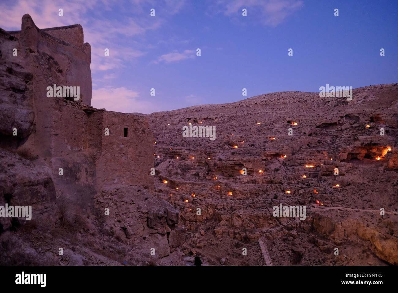 Light candles illuminating small caves near Mar Saba Monastery in the Judaean or Judean desert during Mar Saba Day - Stock Image