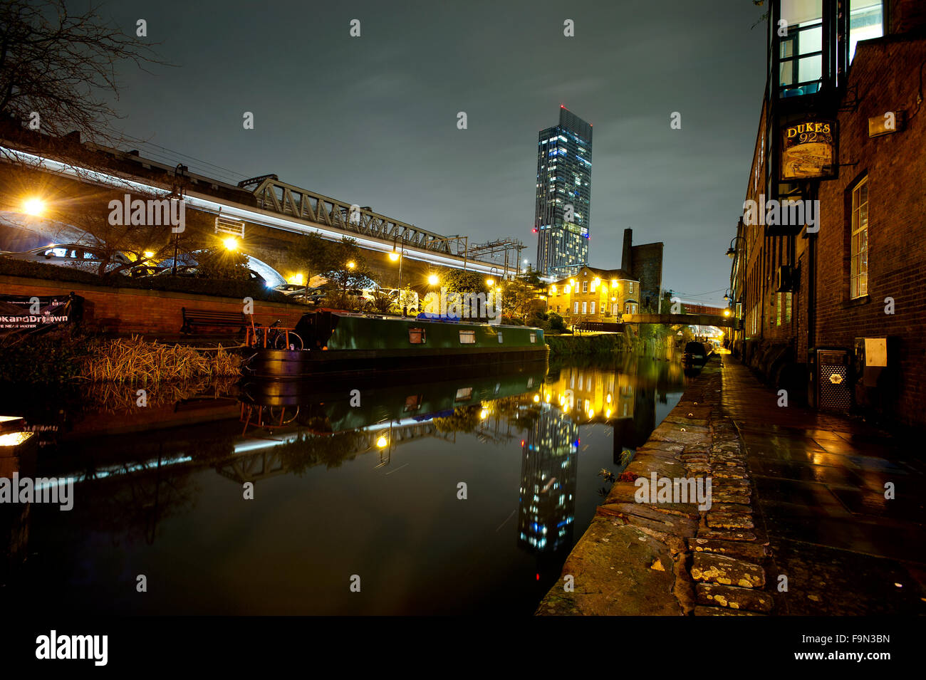 Night time image of the Castlefield basin of the Rochdale Canal, Manchester city centre. Picture by Paul Heyes, - Stock Image