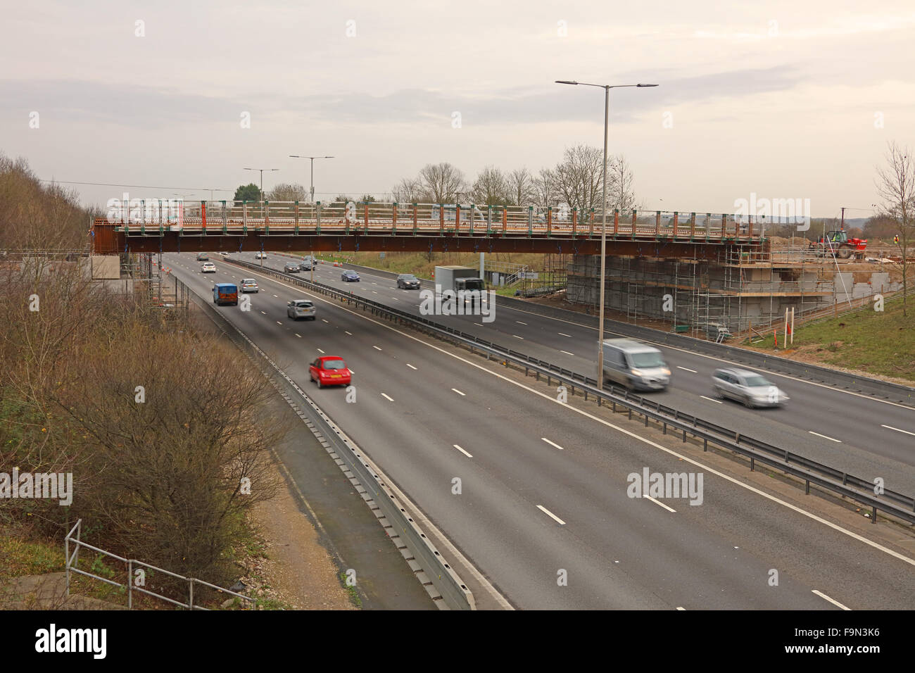 A new bridge over the M4 motorway under construction have had the steel support beams put in place a couple of nights - Stock Image