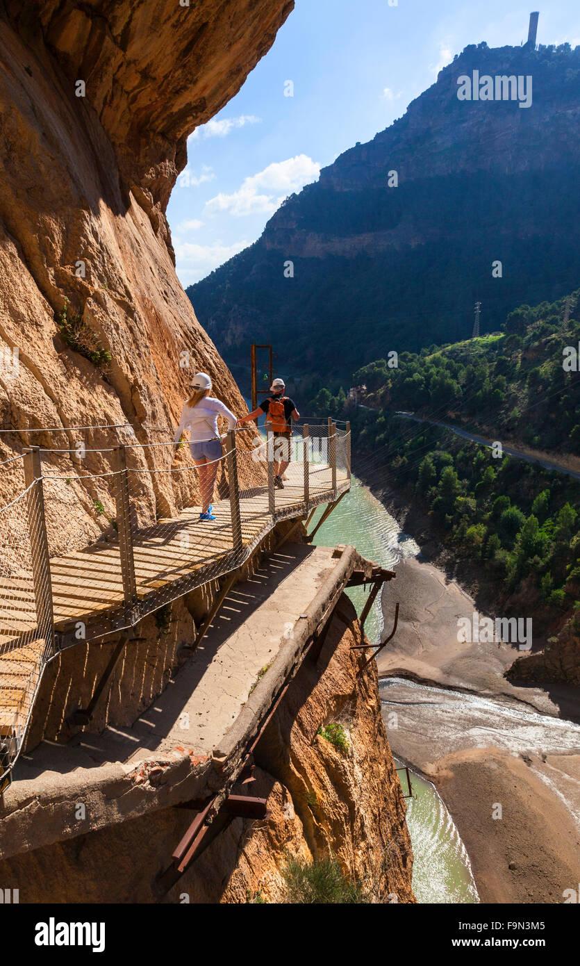 Walkers on El Caminito del Rey walkway, pinned to the steep walls of a narrow gorge in El Chorro,  Málaga, - Stock Image