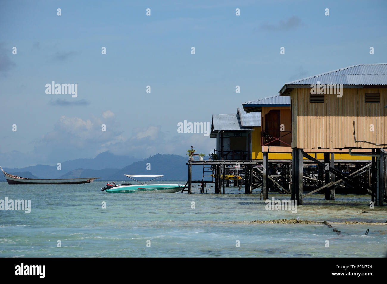 Houses on stilts in Mabul island Malaysia - Stock Image