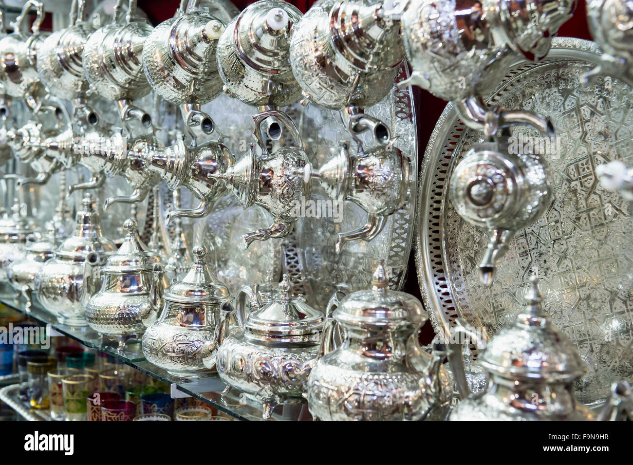 Moroccan silver plates and teapots, Morocco - Stock Image