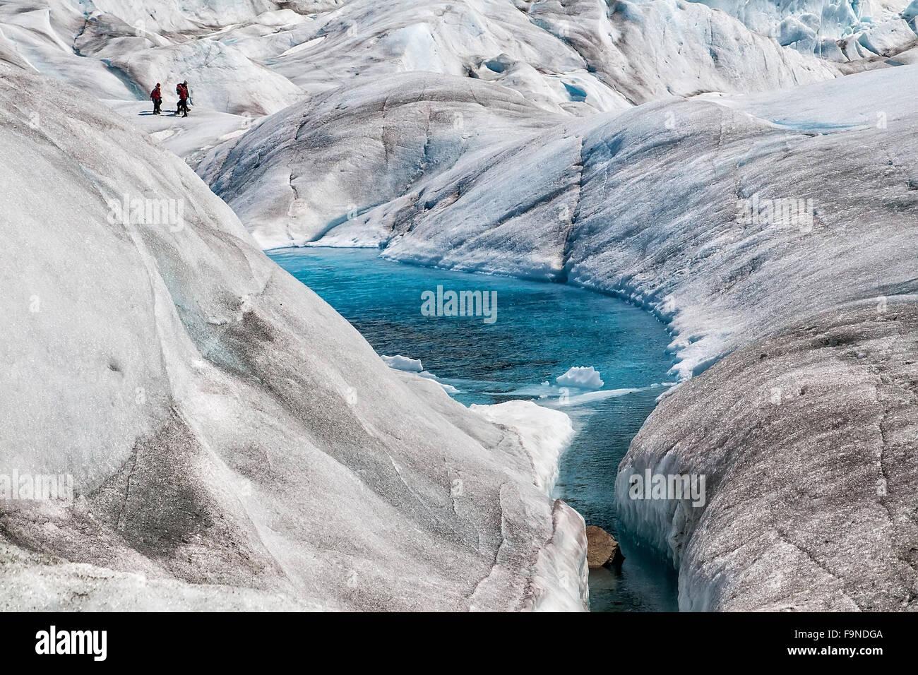 Natural blue-colored pools on Mendenhall Glacier in Juneau, Alaska. - Stock Image