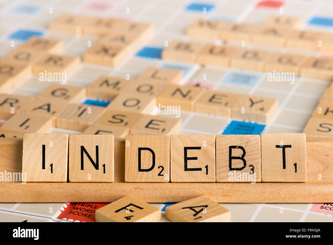 Scrabble - IN DEBT - Stock Image