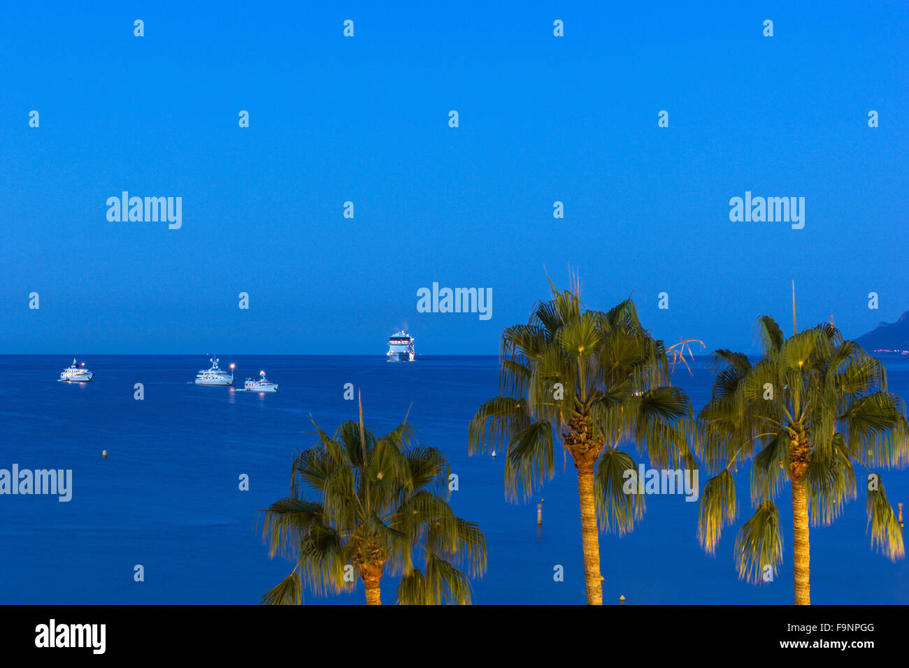 Ships on Mediterranean Sea near the shores of Cannes on French Riviera - Stock Image