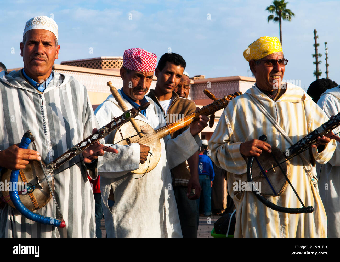 Berber musicians playing the Imzad  ( single string instrument ) in the Djema el-Fna sq. in Marrakesh. Stock Photo