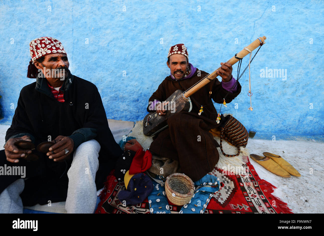 Gnawa musicians playing the Sintir and the Krakebs in the kasbah or Rabat. - Stock Image