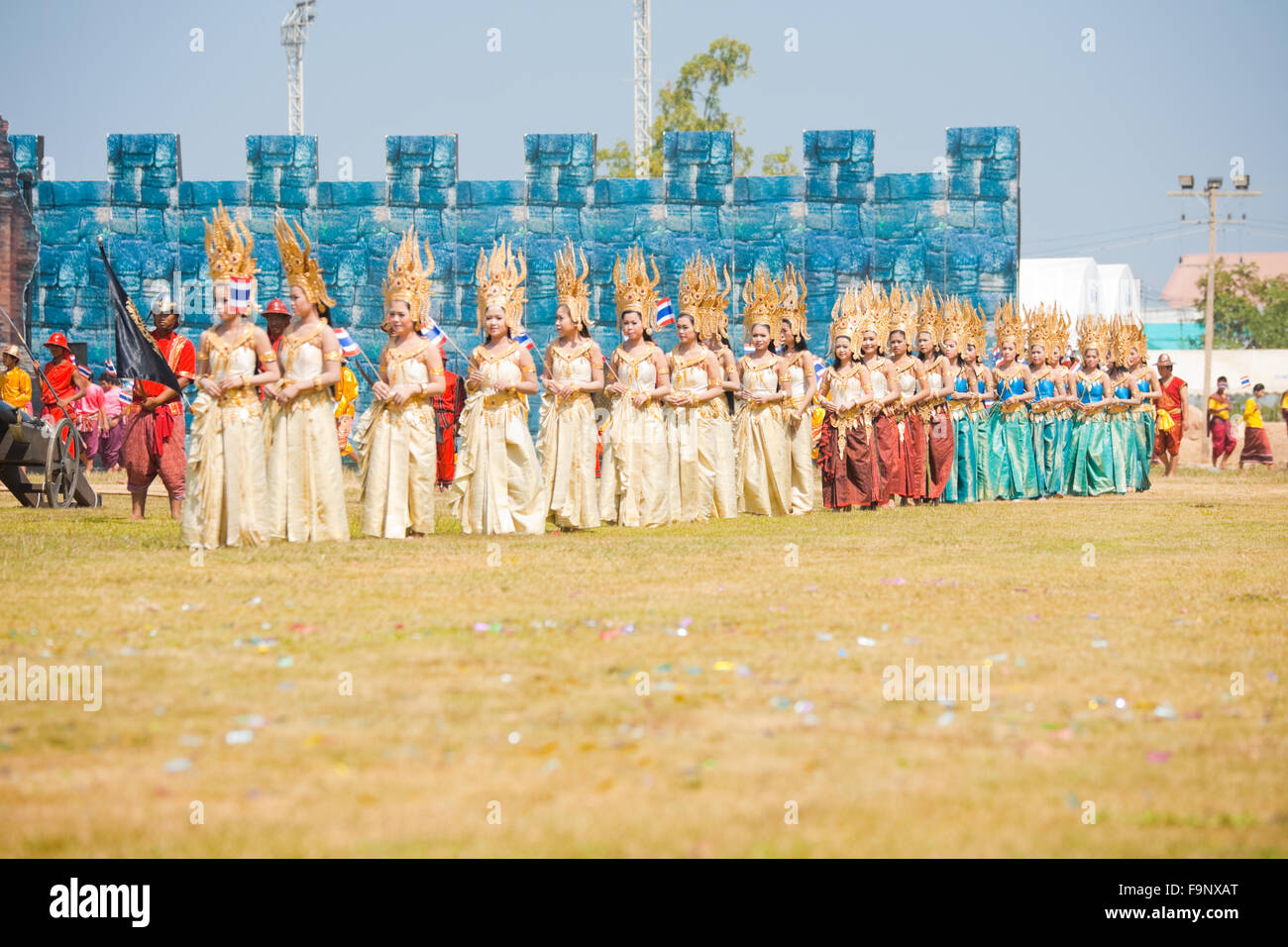 Beautifully dressed Thai dancers enter the stage to perform on field at the annual Surin Elephant Roundup Stock Photo