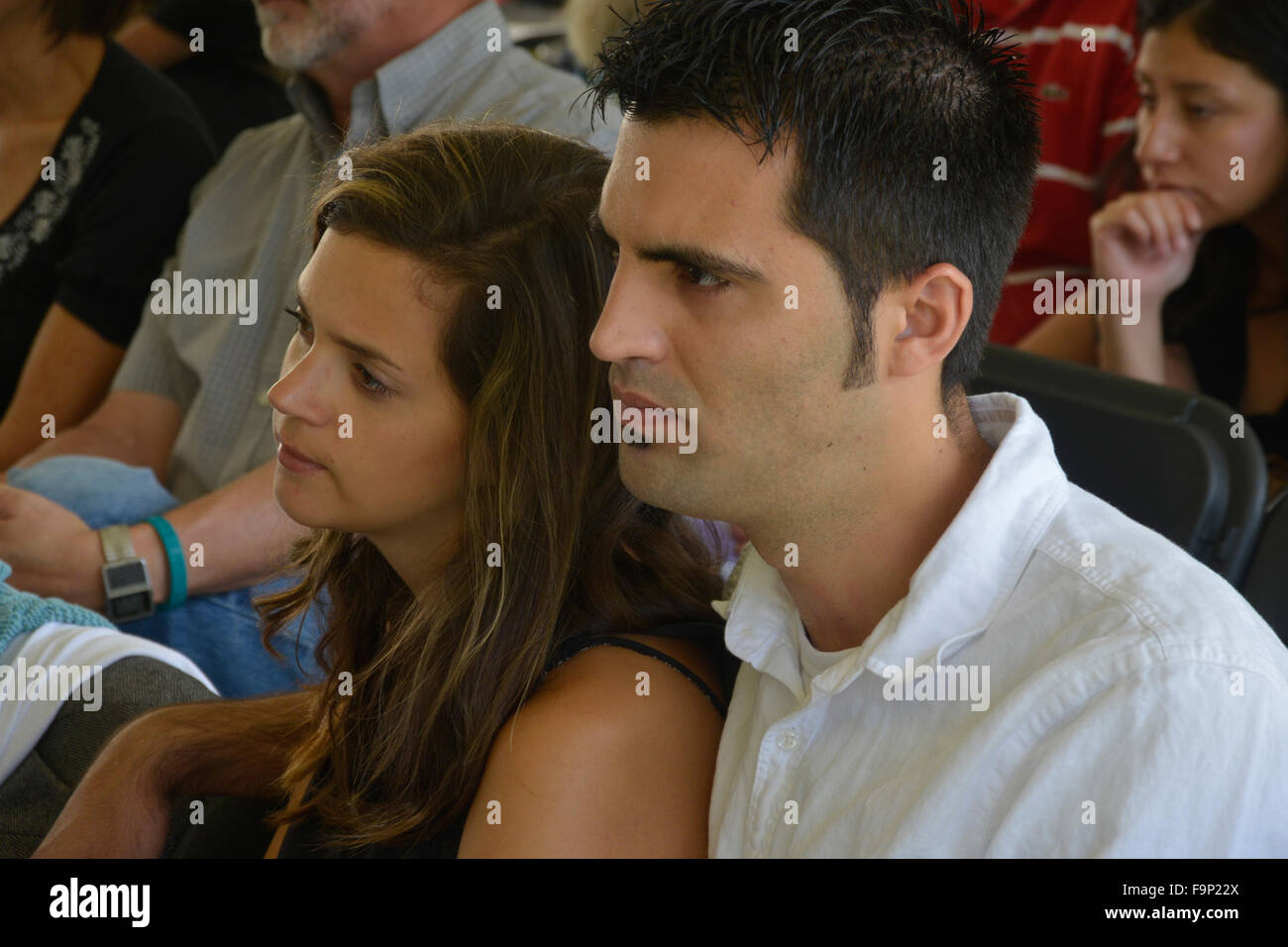 Couple listens intently to the Sunday sermon at a tent revival in Riverdale Park, Md - Stock Image