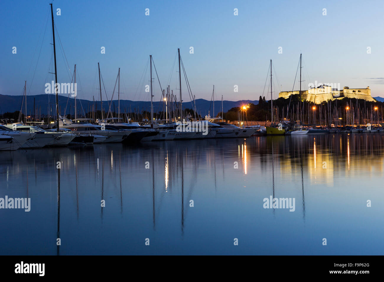 View on Fort Carre and boats anchored in the harbor in Antibes in France in the morning - Stock Image