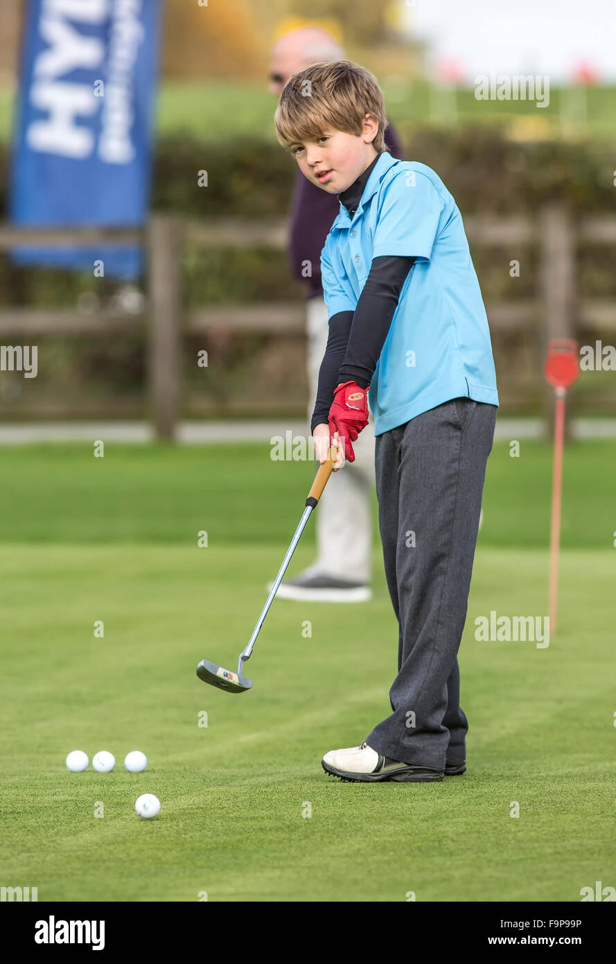 Young Man practices his putting at Bassett Down Golf Club - Stock Image