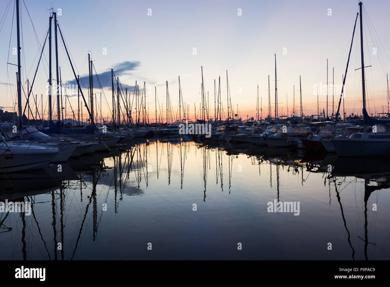 Boats anchored in the harbor in Antibes in France - Stock Image