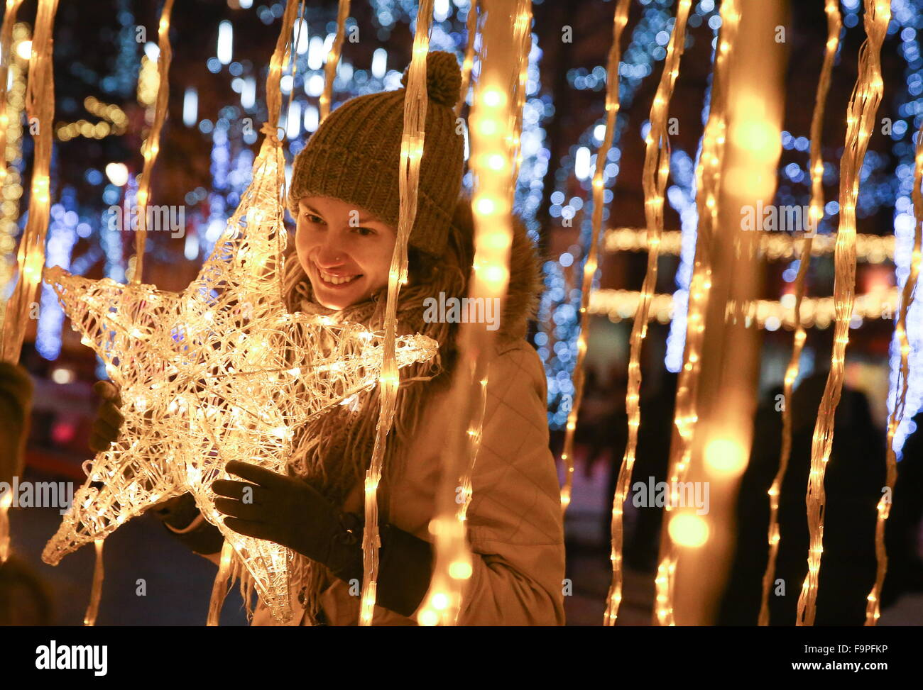 Moscow, Russia. 17th Dec, 2015. A girl in Tverskoy Boulevard decorated for the upcoming holidays as part of the Stock Photo