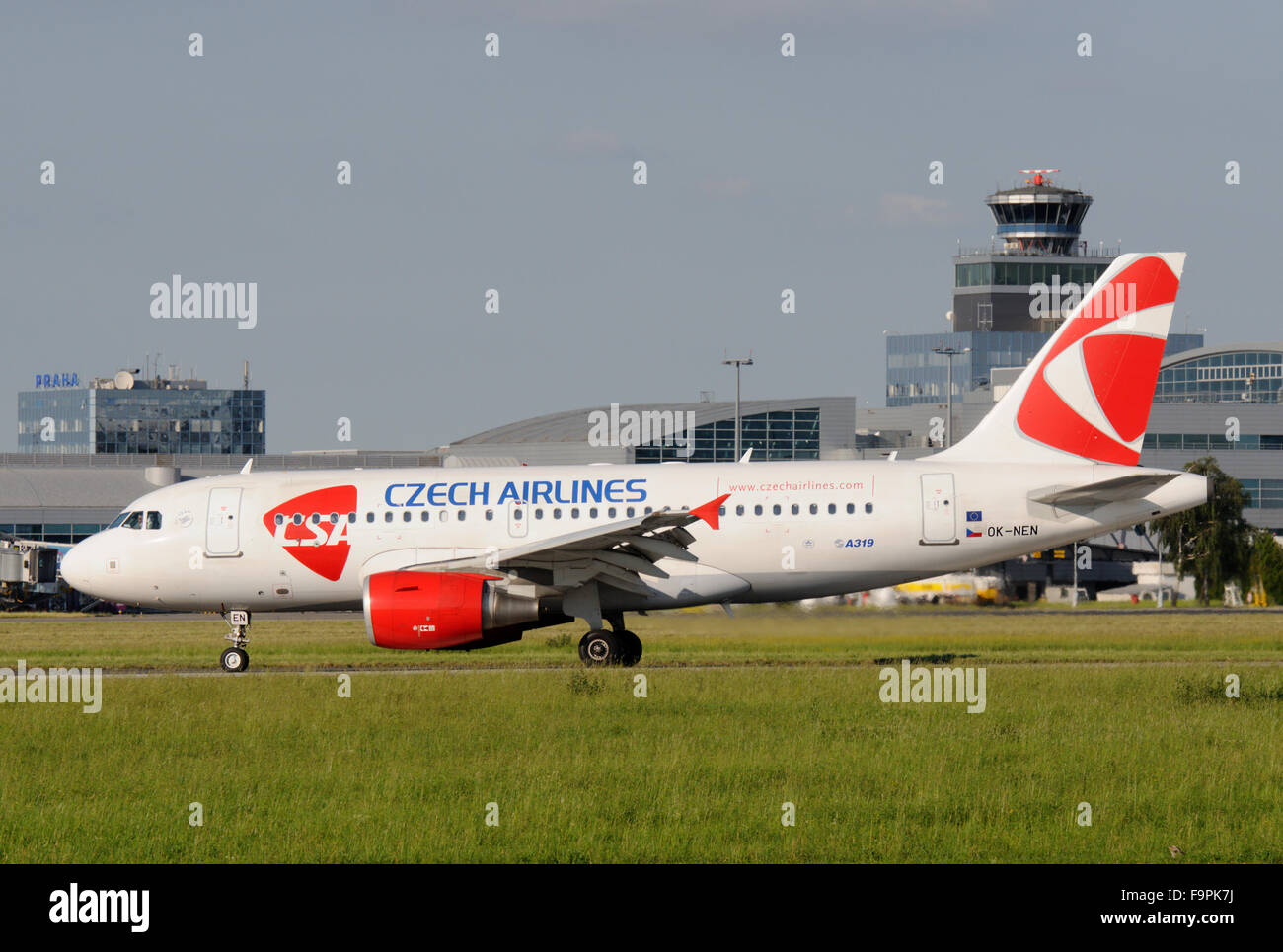 Czech Airlines Airbus  A319 on taxiway with ATC and terminals - Stock Image