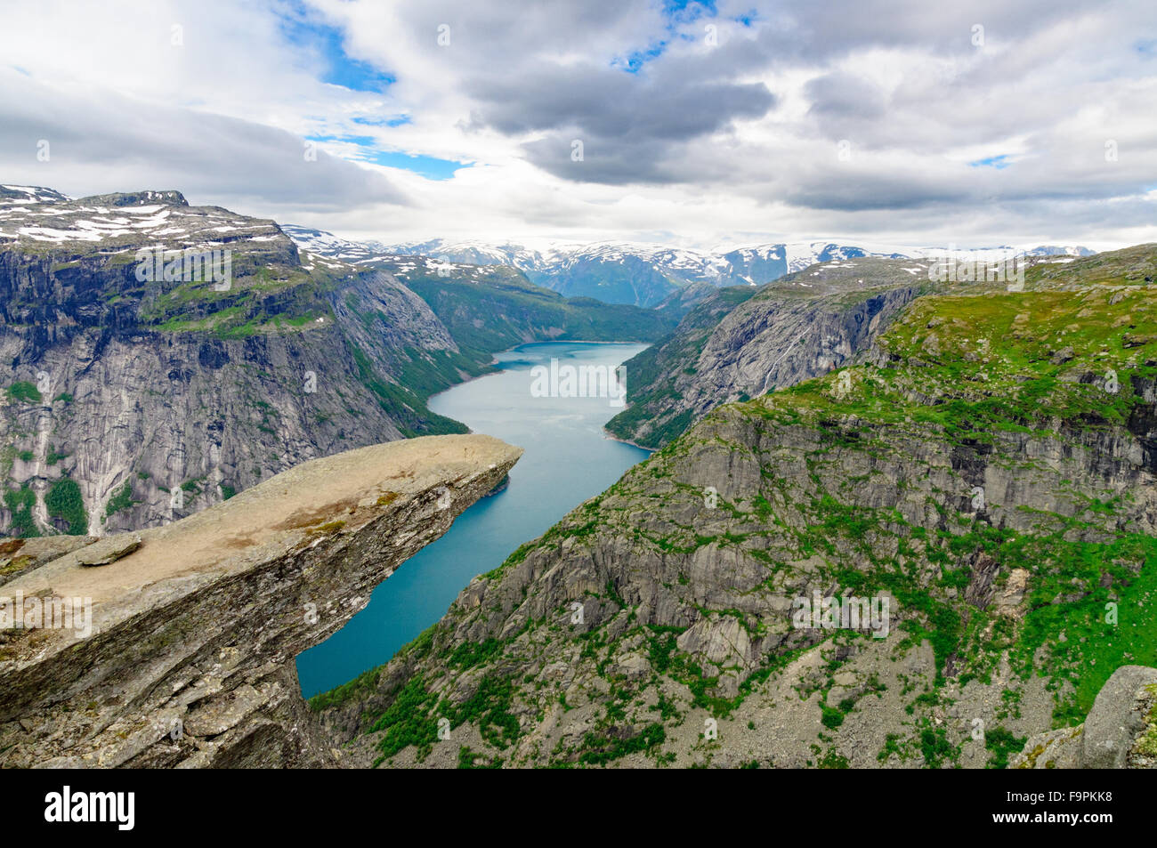 Troll's tongue (Trolltunga) rock above lake Ringedalsvatnet. One of the popular sight places in Norway - Stock Image