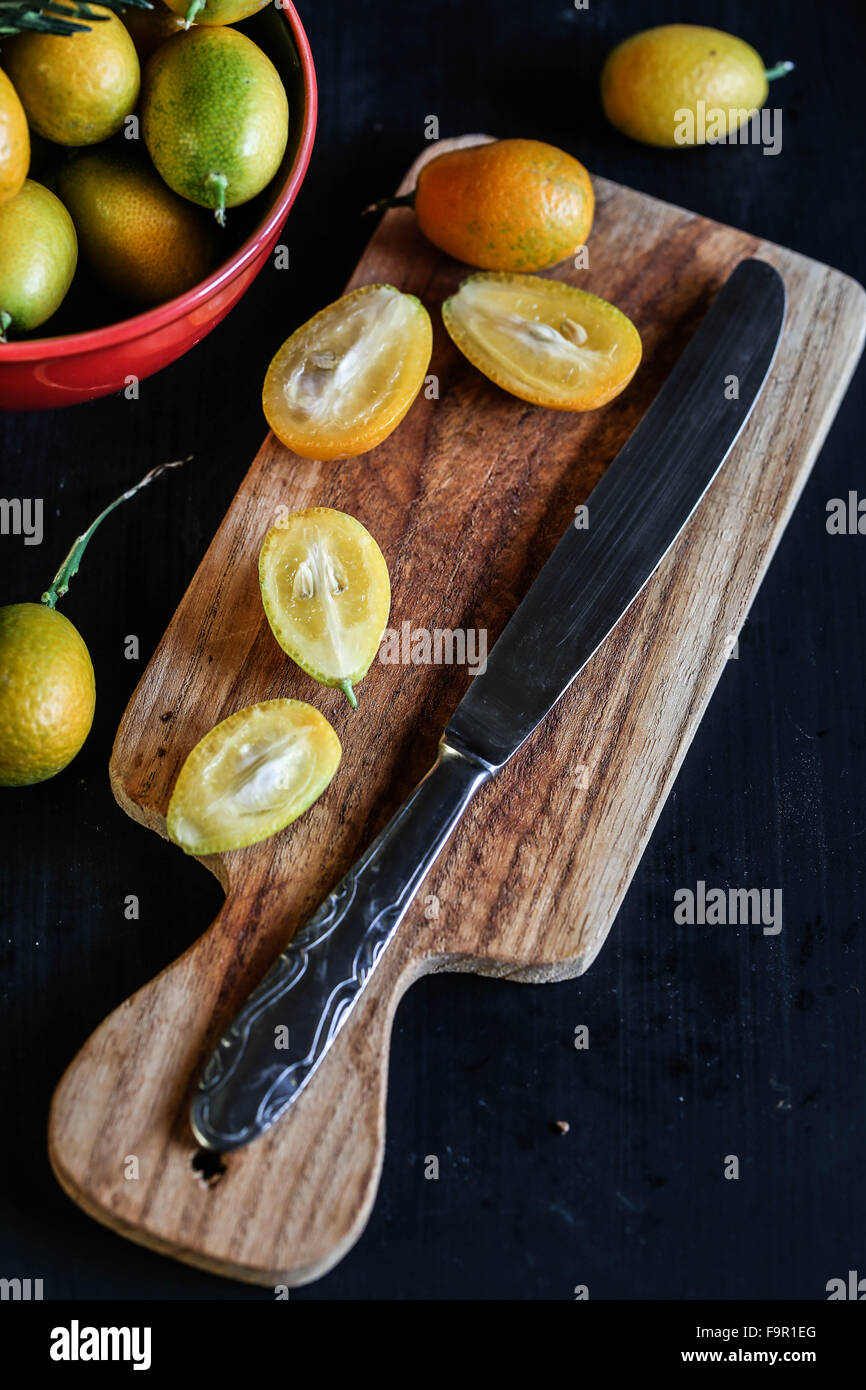 Detail of Kumquat on wooden board Stock Photo