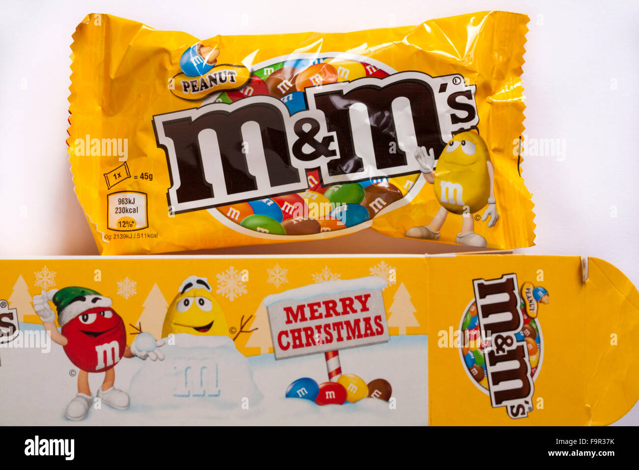 Box of Merry Christmas peanut M&M\'s with packet removed set on white ...