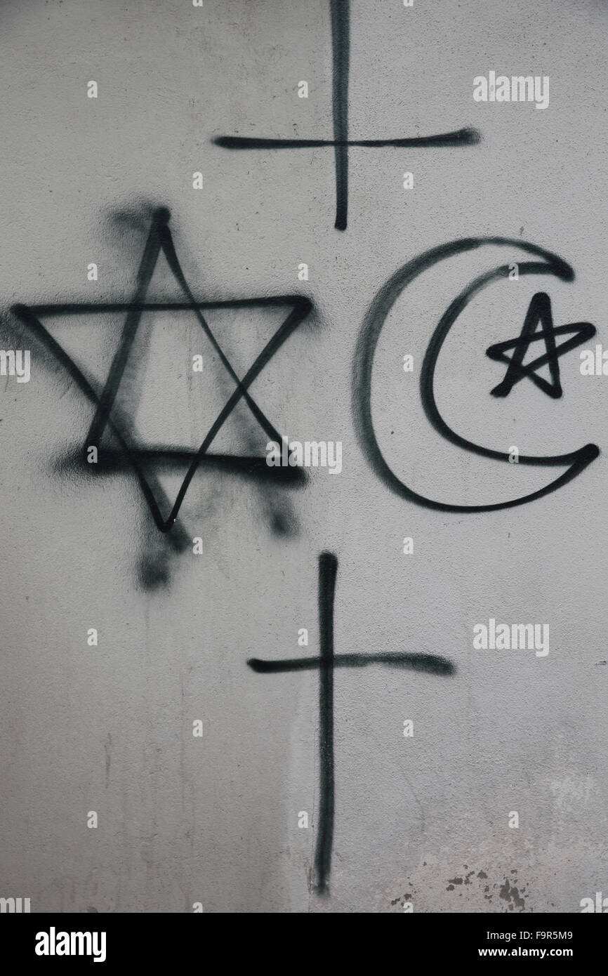 Religious symbols tagged on a wall. Stock Photo