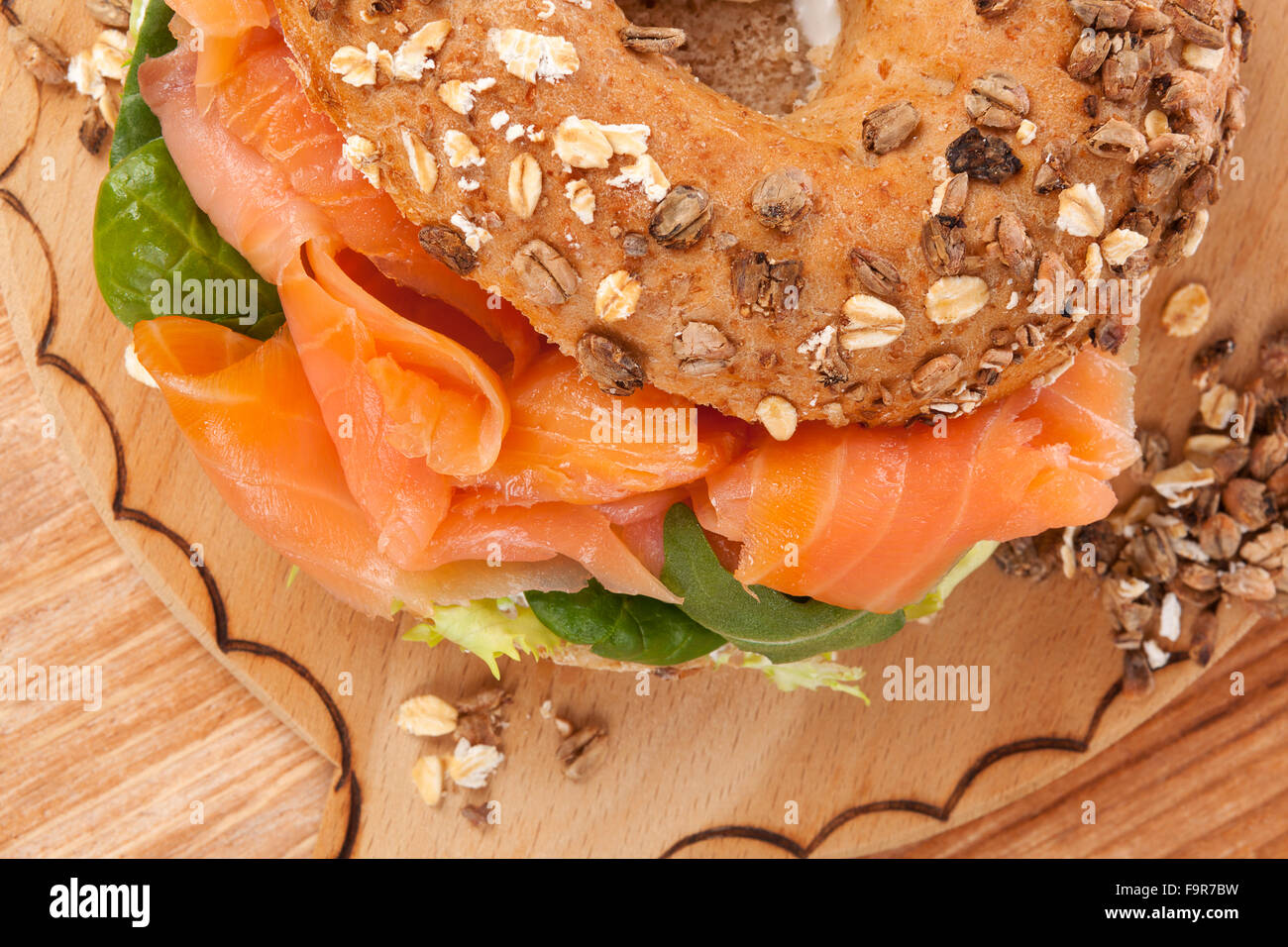 Culinary bagel eating. - Stock Image