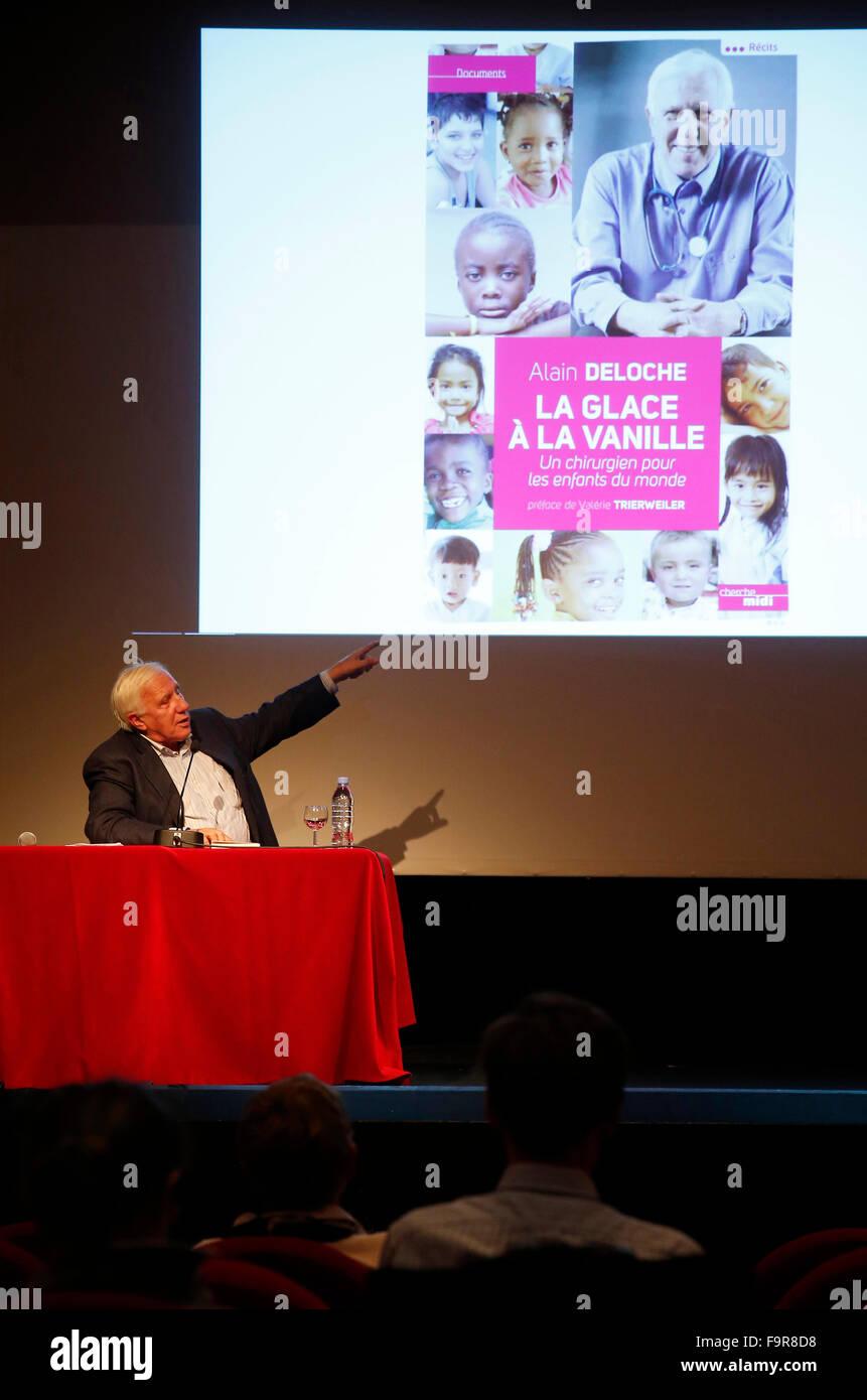 Pr. Alain Deloche giving a speech. - Stock Image