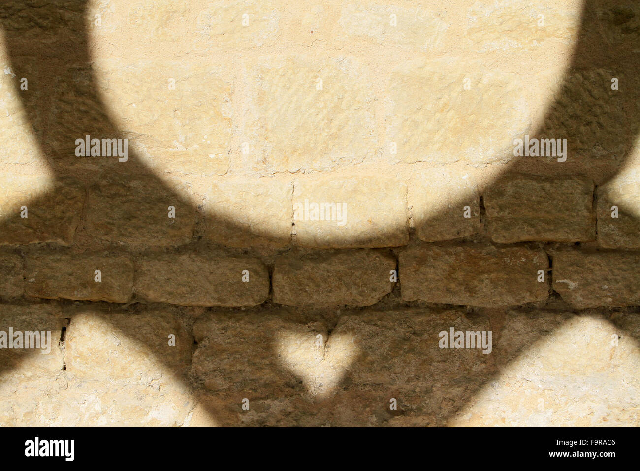 Cloister. Stone and geometrical shadow. Noirlac Abbey. - Stock Image