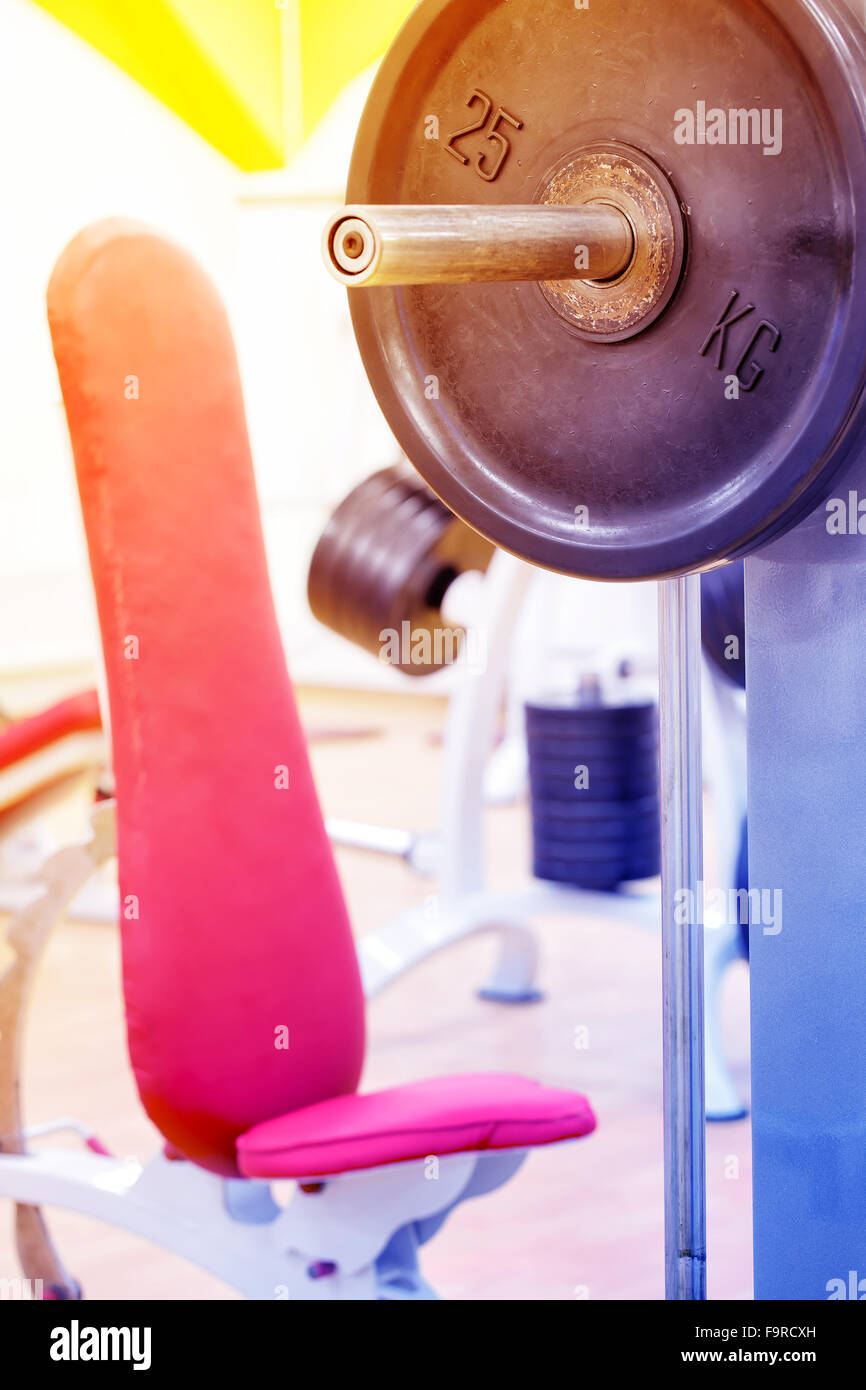 Detail of bar and bench for bench press in gym Stock Photo