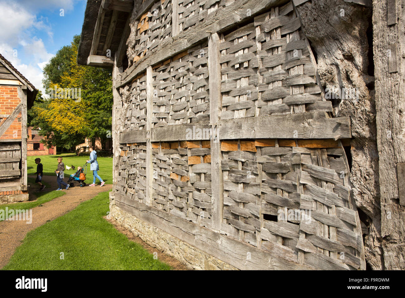 UK, England, Worcestershire, Bromsgrove, Avoncroft Museum, Thatched Threshing Barn, and timber framed stable - Stock Image