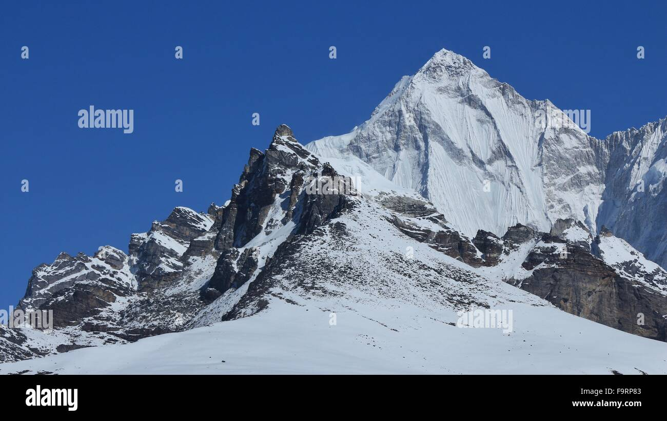 Pointed mountain Palung Ri, Gokyo valley - Stock Image