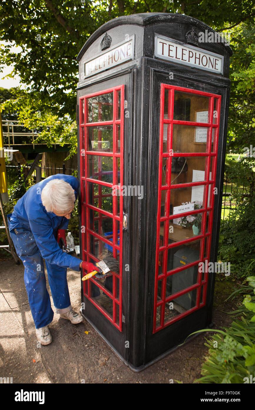 UK, England, Worcestershire, Bromsgrove, Avoncroft Museum, National Telephone Kiosk Collection, volunteer Roger - Stock Image