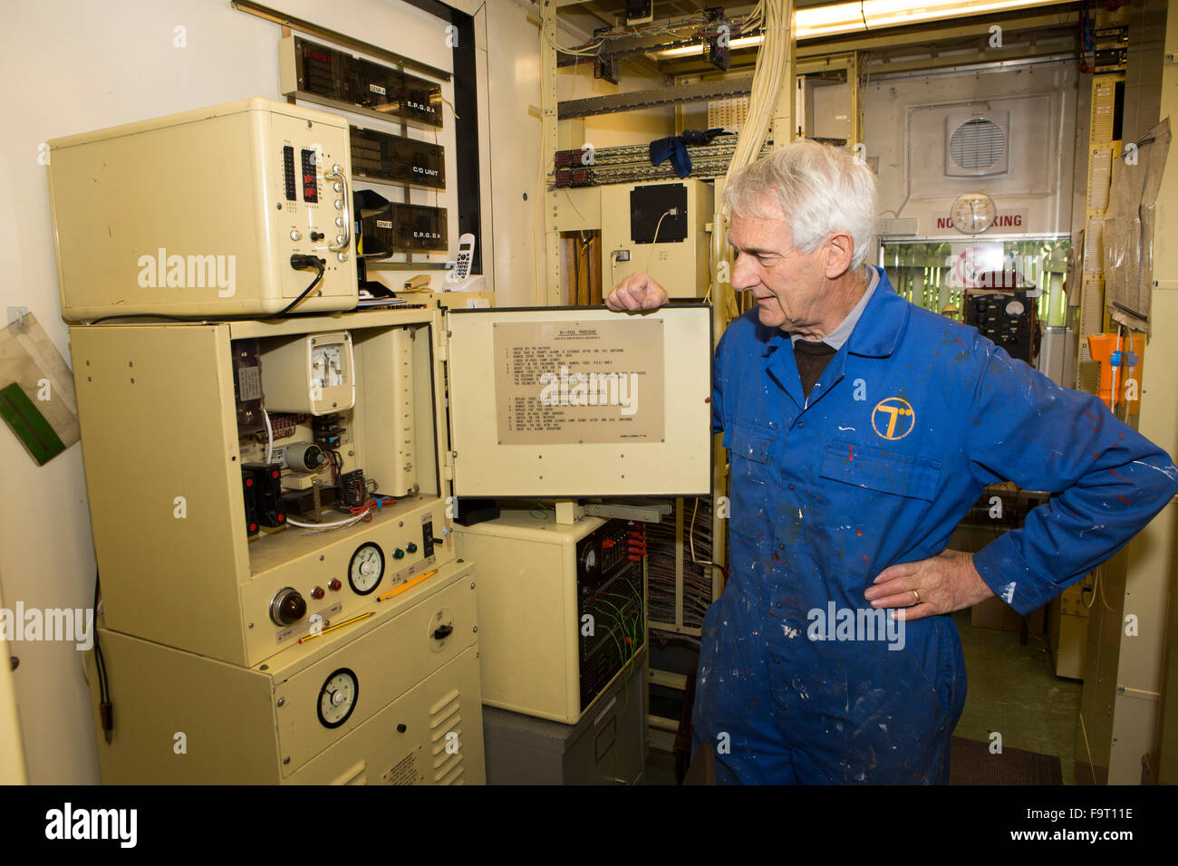 UK, England, Worcestershire, Bromsgrove, Avoncroft Museum, National Telephone Kiosk Collection, volunteer Roger - Stock Image
