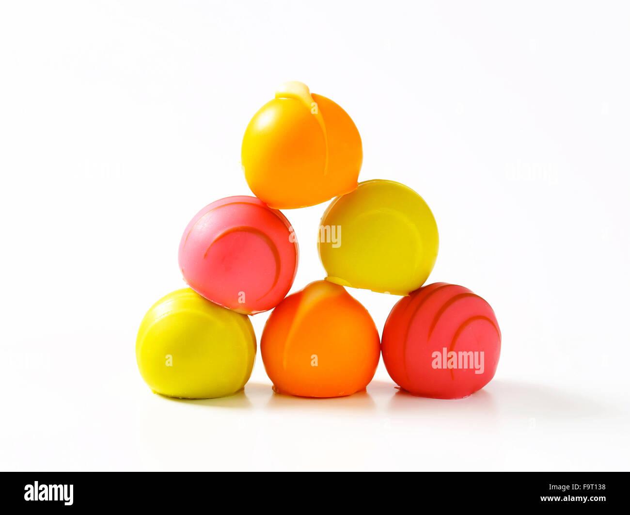 White chocolate bonbons with fruit ganache filling Stock Photo