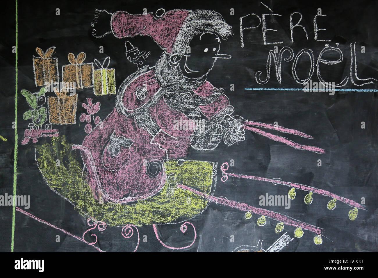 Chalk drawing of Santa Claus. Blackboard. Stock Photo