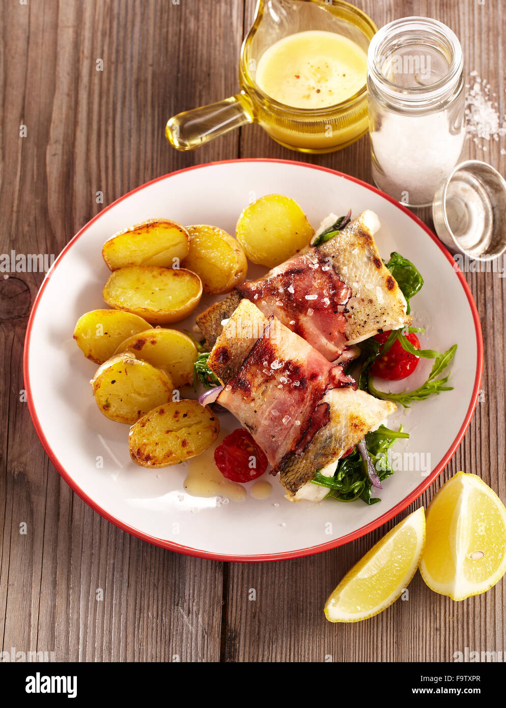 Fish packet with rucola and spinach - Stock Image