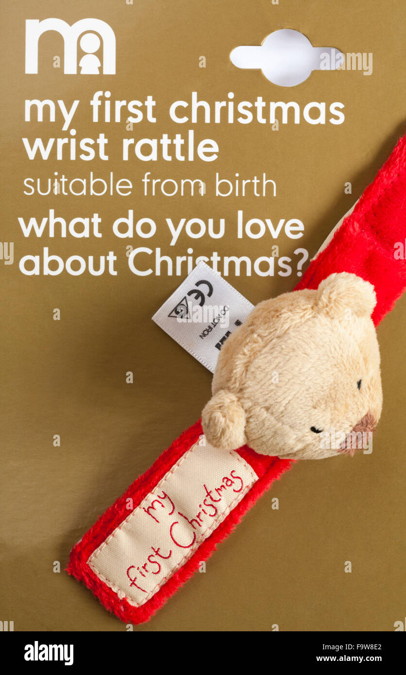 Mothercare my first Christmas wrist rattle suitable from birth what do you love about Christmas - Stock Image