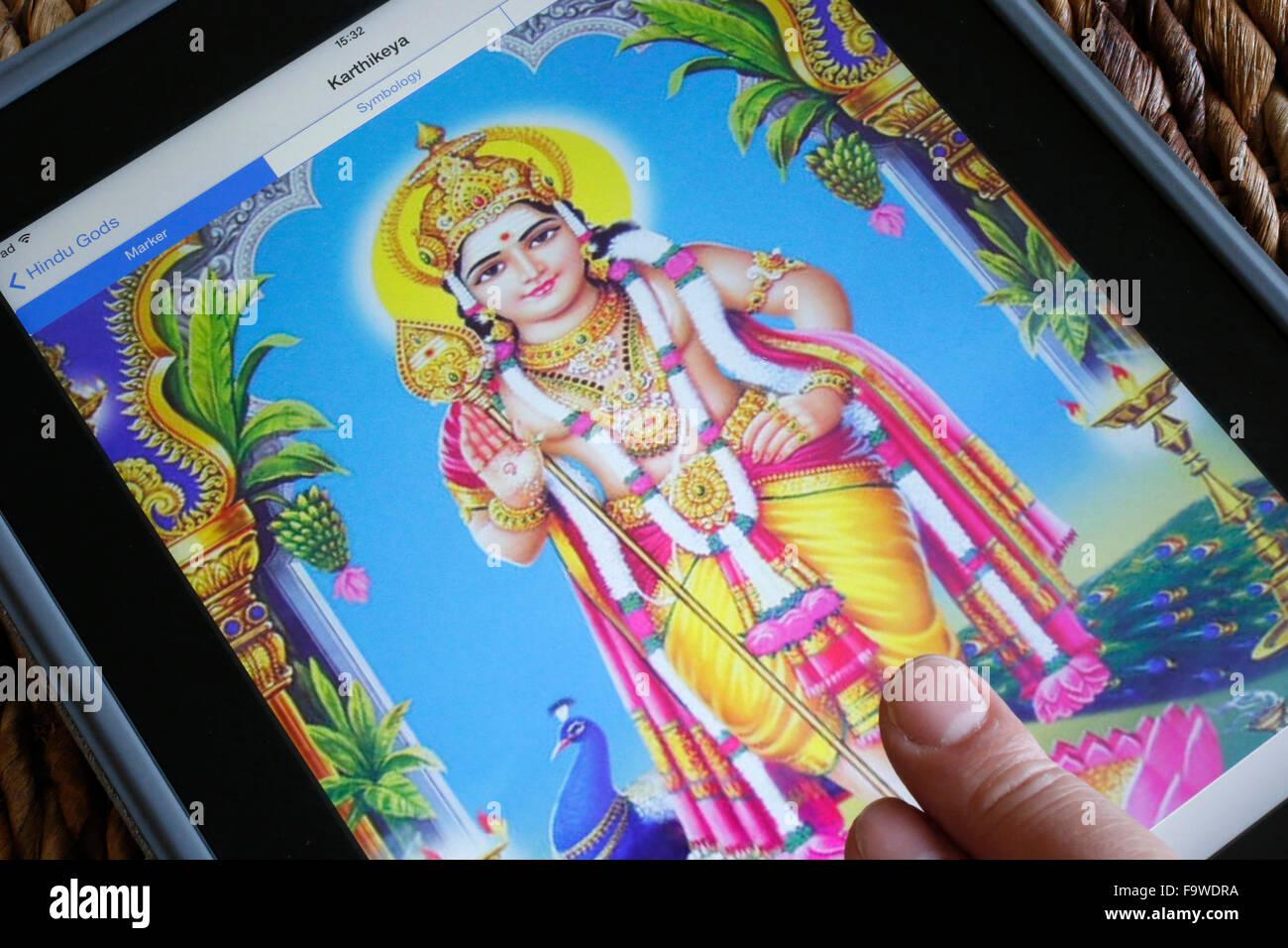 Hindu deity on an Ipad. Karthikeya. - Stock Image