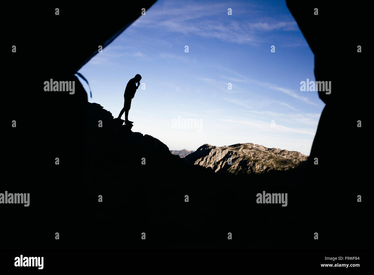 Spain, Picos de Europa, silhouette of a man with mountains landscape - Stock Image