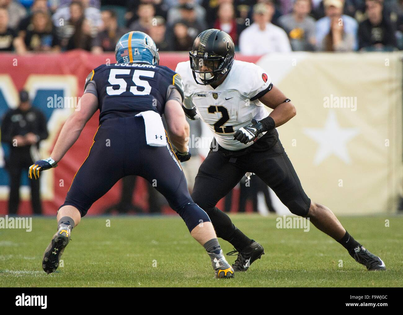 Navy Midshipmen Ted Colburn (55) blocks Army Black Knights tight end Kelvin White (2) during the NCAA football game - Stock Image