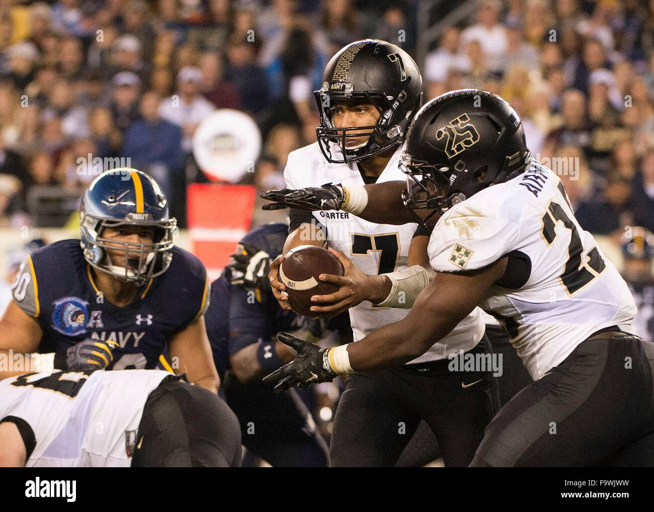 Army Black Knights quarterback Chris Carter (7) hands the ball off to running back Aaron Kemper (25) during the - Stock Image