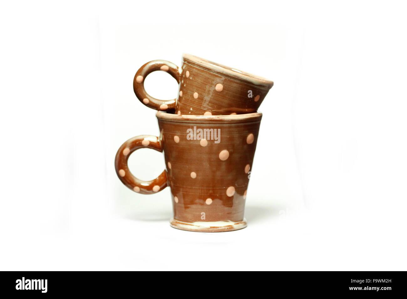 Artisan ceramic mugs made by Sally Bettridge isolated on a white studio background. - Stock Image