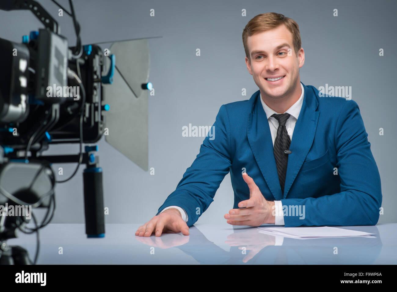 Newsman during shooting process. - Stock Image