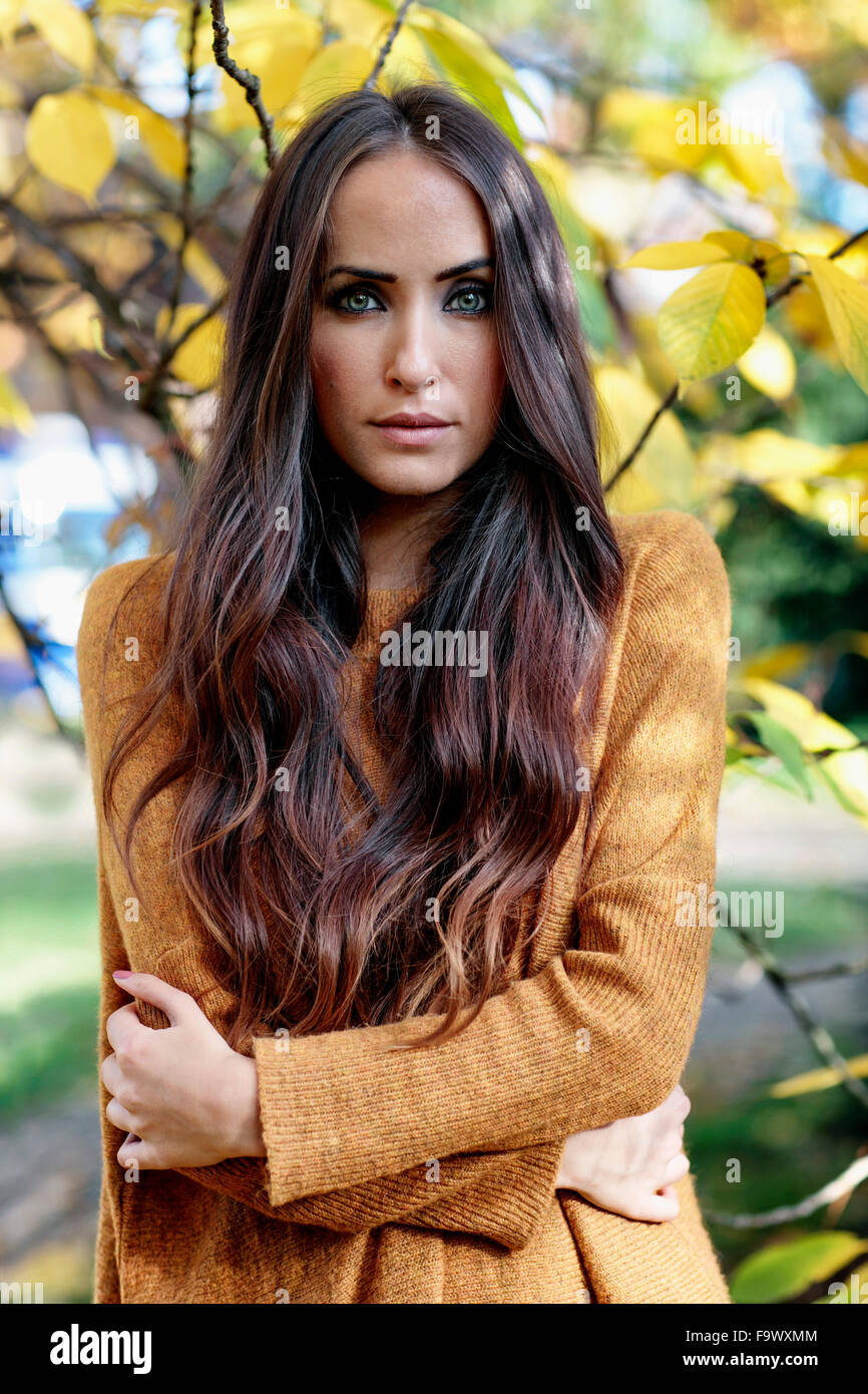 Portrait of freezing young woman with long brown hair - Stock Image